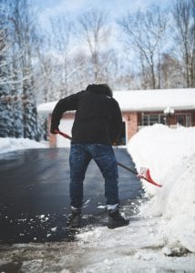 Man shoveling driveway as metaphor for Functional nutitionist anxiety support