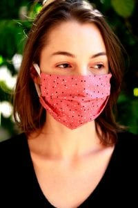 woman wears mask to prevent spread of COVID-19